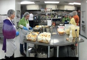Employees at The Gathering Place preparing trifles for dinner.